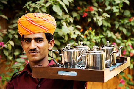 Portrait of a waiter holding the tray of tea kettles, Jodhpur, Rajasthan, India Stock Photo - Rights-Managed, Code: 857-03553579