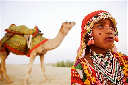 rajasthan camel - Close-up of a girl with a camel in the background, Jaisalmer, Rajasthan, India Stock Photo - Rights-Managed, Code: 857-03553596