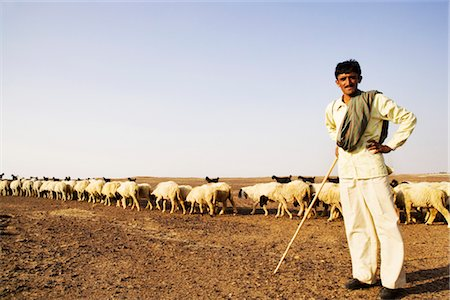 Portrait of a shepherd standing with arms akimbo, Jaisalmer, Rajasthan, India Stock Photo - Rights-Managed, Code: 857-03553592
