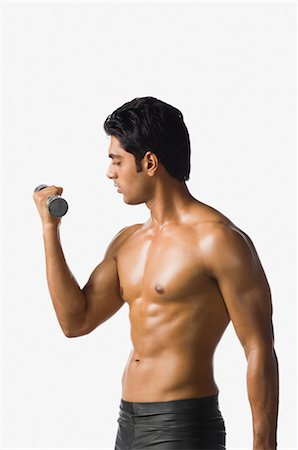 Man exercising with a dumbbell Stock Photo - Rights-Managed, Code: 857-03553906