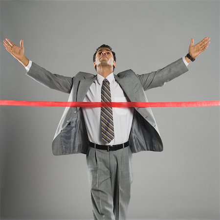 Businessman crossing the finishing line Stock Photo - Rights-Managed, Code: 857-03553946