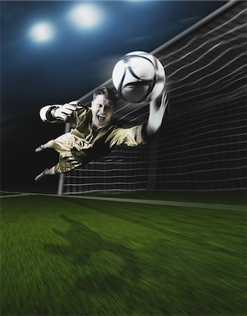 Young Goal Keeper Making a Save Stock Photo - Rights-Managed, Code: 858-05604665