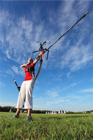 Young Female Archer Aiming at Target Stock Photo - Rights-Managed, Code: 858-05604827