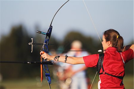 Young Female Archer Aiming at Target Stock Photo - Rights-Managed, Code: 858-05604886