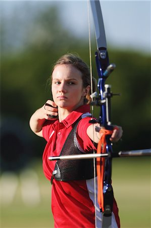 Young Female Archer Aiming at Target Stock Photo - Rights-Managed, Code: 858-05604895