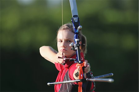 Young Female Archer Aiming at Target Stock Photo - Rights-Managed, Code: 858-05604896