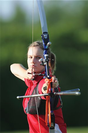 Young Female Archer Aiming at Target Stock Photo - Rights-Managed, Code: 858-05604897