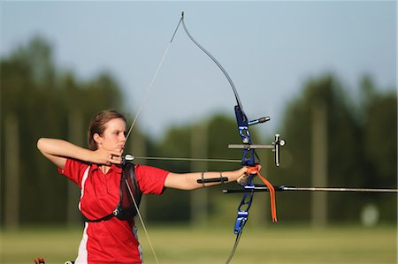 Young Female Archer Aiming at Target Stock Photo - Rights-Managed, Code: 858-05604891