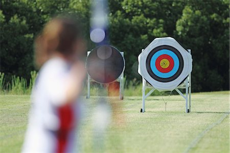 Young Female Archer Aiming at Target Stock Photo - Rights-Managed, Code: 858-05604905