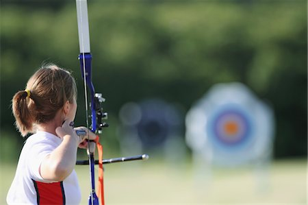 Young Female Archer Aiming at Target Stock Photo - Rights-Managed, Code: 858-05604906