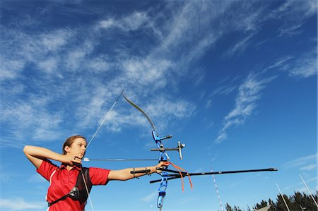 Young Female Archer Aiming at Target Stock Photo - Rights-Managed, Code: 858-05604909