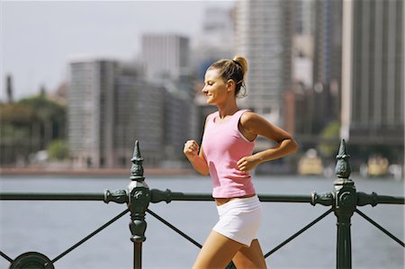 Young Woman Running Stock Photo - Rights-Managed, Code: 858-05799385