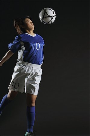 Japanese Woman Playing With Football Stock Photo - Rights-Managed, Code: 858-06118954