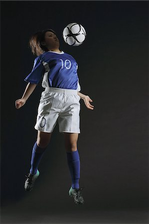 Japanese Woman Playing With Football, Mid Air Stock Photo - Rights-Managed, Code: 858-06118955
