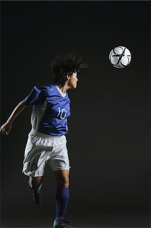Female Football Player Playing Stock Photo - Rights-Managed, Code: 858-06118957