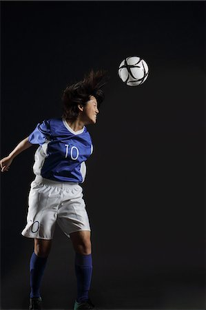 Japanese Young Sportswoman Hitting Soccer Stock Photo - Rights-Managed, Code: 858-06118959