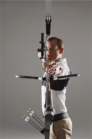 Archer Aiming With Bow And Arrow Stock Photo - Rights-Managed, Code: 858-06121546