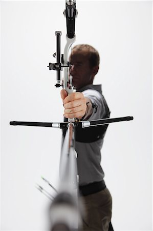 Male Archer Taking Aim Stock Photo - Rights-Managed, Code: 858-06121549