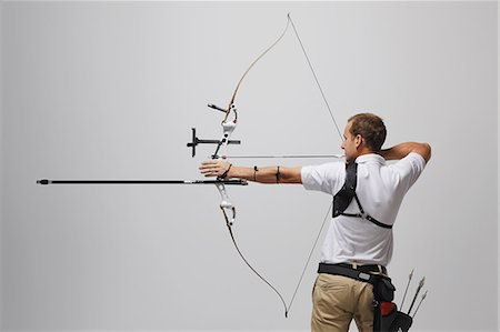 Man Aiming With Bow And Arrow Stock Photo - Rights-Managed, Code: 858-06121540