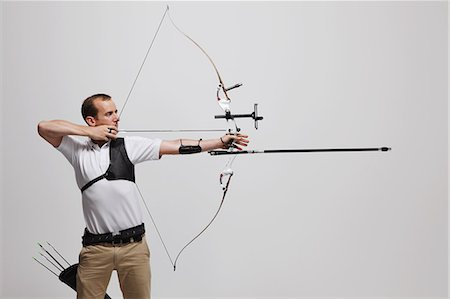 Man Archer Aiming Arrow Stock Photo - Rights-Managed, Code: 858-06121541