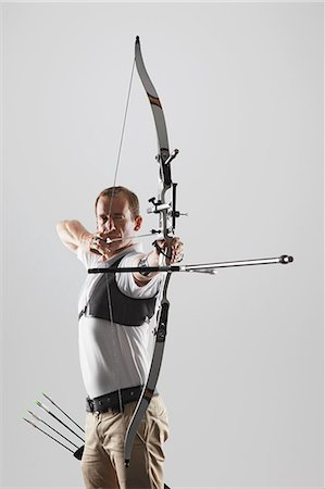 Archer Taking Aim With Bow Stock Photo - Rights-Managed, Code: 858-06121543