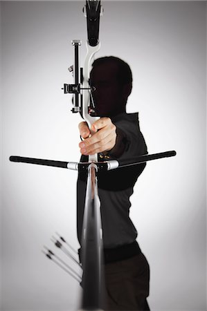 Archer Aiming With Backlit Stock Photo - Rights-Managed, Code: 858-06121550