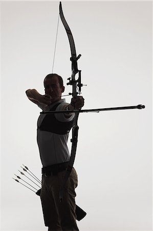 Archer Aiming With Gradient Background Stock Photo - Rights-Managed, Code: 858-06121552