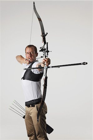 Archer Taking Aim With Bow Stock Photo - Rights-Managed, Code: 858-06121553