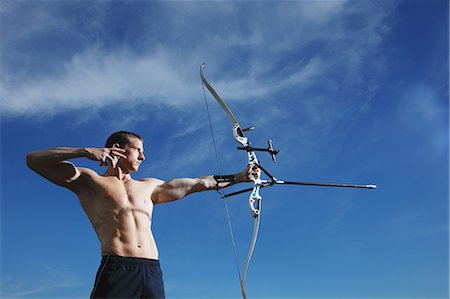 Man Practicing Archery Stock Photo - Rights-Managed, Code: 858-06617626