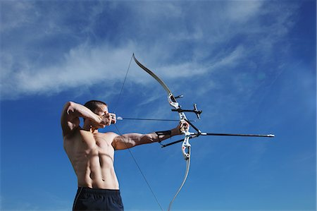 Man Practicing Archery Stock Photo - Rights-Managed, Code: 858-06617627