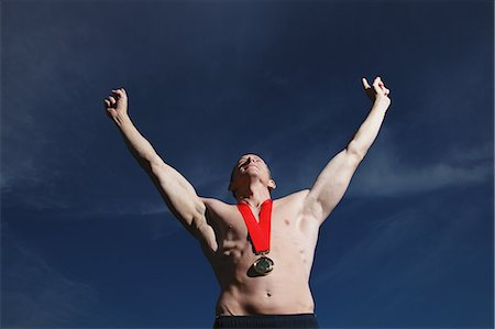 Man Wearing a Gold Medal Stock Photo - Rights-Managed, Code: 858-06617638