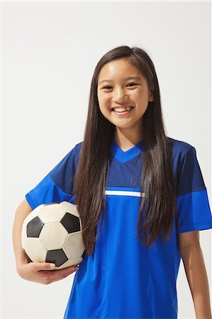 preteen  smile  one  alone - Girl Posing In Soccer Uniform With Ball Stock Photo - Rights-Managed, Code: 858-06617684