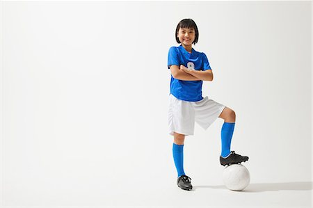 preteen asian girls - Girl Posing In Soccer Uniform With Ball Stock Photo - Rights-Managed, Code: 858-06617685