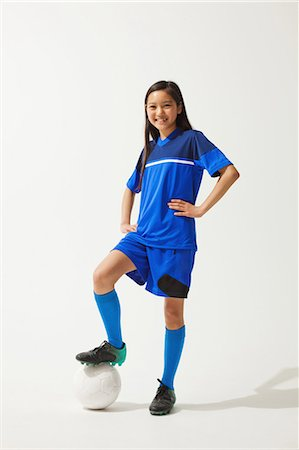 preteen asian girls - Girl Posing In Soccer Uniform With Ball Stock Photo - Rights-Managed, Code: 858-06617680