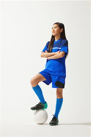 preteen asian girls - Girl Posing In Soccer Uniform With Ball Stock Photo - Rights-Managed, Code: 858-06617681