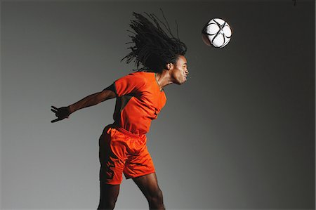 dynamic - Man In Soccer Uniform With Ball Stock Photo - Rights-Managed, Code: 858-06617786