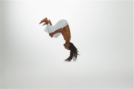 Man Practicing Capoeira Fotografie stock - Rights-Managed, Codice: 858-06617798