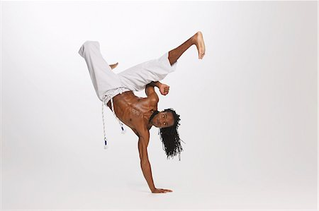dynamic - Man Practicing Capoeira Stock Photo - Rights-Managed, Code: 858-06617792