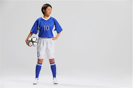 Woman In Soccer Uniform Posing With Ball Stock Photo - Rights-Managed, Code: 858-06617814