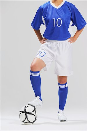 footballeur - Woman In Soccer Uniform Posing With Ball Stock Photo - Rights-Managed, Code: 858-06617812