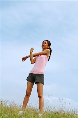 Woman Exercising In A Meadow Stock Photo - Rights-Managed, Code: 858-06756047