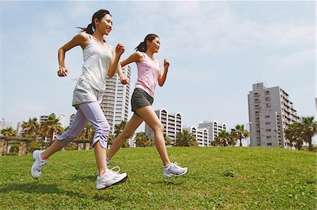 Friends Jogging On Grass Stock Photo - Rights-Managed, Code: 858-06756062