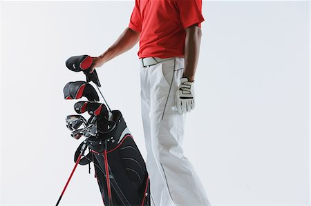 Golfer with Golf-Club Bag,  Low-Section Stock Photo - Rights-Managed, Code: 858-06756144