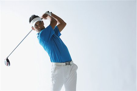 swing (sports) - Portrait Of Golfer Swinging Stock Photo - Rights-Managed, Code: 858-06756149