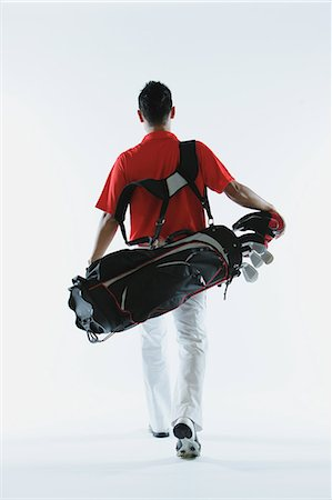 Golfer Carrying Golf-Club Bag Stock Photo - Rights-Managed, Code: 858-06756140
