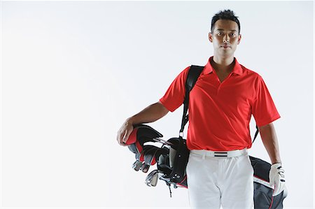 Golfer Carrying Golf-Club Bag Stock Photo - Rights-Managed, Code: 858-06756142
