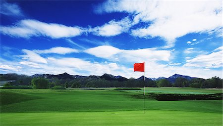 Golf Flag On Green With Cloudy Sky Stock Photo - Rights-Managed, Code: 858-06756389