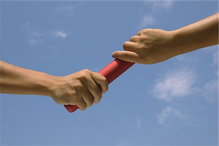 Relaying a Baton Stock Photo - Rights-Managed, Code: 858-03044318