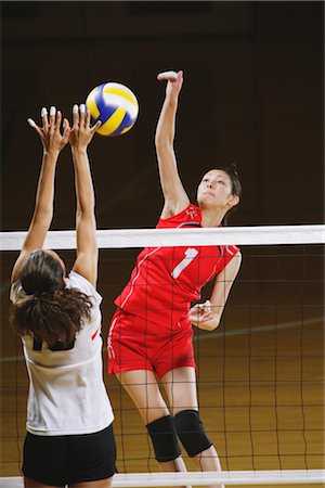 spike - Volleyball Players in Intense Moment Stock Photo - Rights-Managed, Code: 858-03046885