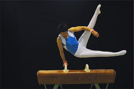 Gymnast performing scissors routine on pommel horse Stock Photo - Rights-Managed, Code: 858-03047726